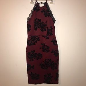 Burgundy dress with lace and velvet rose detailing